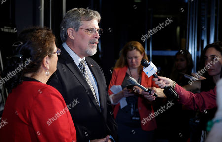 "Richard Phillips, Andrea Phillips Andrea Phillips, left, and her husband Captain Richard Phillips, are interviewed as they walk the red carpet at a screening for the movie ""Captain Phillips"" at the Newseum, in Washington"