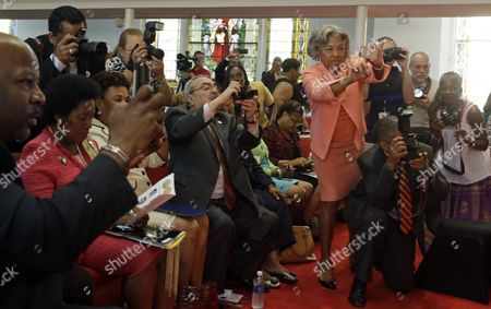GK Butterfield Joyce Beatty Churchgoer's, including members of Congress, like U.S. Rep. Joyce Beatty, D-Ohio, 5th from right, photograph events at the 16th Street Baptist Church in Birmingham, Ala., . Seated at center is U.S. Rep. G.K. Butterfield, D-N.C