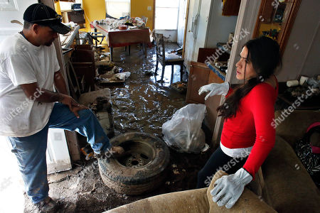 Raul Hernandez, Sonia Marquez Immigrant worker Raul Hernandez, and Sonia Marquez, an organizer with the Colorado Immigrant Rights Coalition, survey the flood damage inside Hernandez's home, which was declared uninhabitable due to permanent damage at a trailer park in Evans, Colo. The majority of the residents in the trailer park are immigrants who didn't have flood insurance, and because some are not citizens or legal residents, they can't get government help