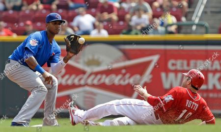 Joey Votto, Starlin Castro Cincinnati Reds' Joey Votto (19) steals second base as Chicago Cubs shortstop Starlin Castro catches the throw from catcher Welington Castillo in the third inning of a baseball game, in Cincinnati
