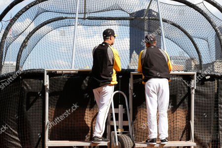 Jay Bell, Jeff Branson Pittsburgh Pirates hitting coaches Jay Bell, left, and Jeff Branson talk as they watch batting practice from the back of the batting cage before the baseball game against the Arizona Diamondbacks, in Pittsburgh