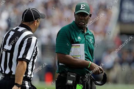 Ron English Eastern Michigan head coach Ron English, right, listens to a linesman during the second quarter of an NCAA college football game against Penn State in State College, Pa., . Penn State won 45-7