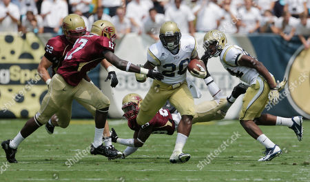 Georgia Tech running back David Sims (20) is pursued by Elon defensive back Jeremy Gloston (17) during the first half of their NCAA college football game in Atlanta