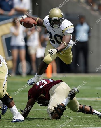 David Sims Georgia Tech running back David Sims (20) leaps over Elon defensive lineman Gary Coates (91)in the first quarter of an NCAA college football game in Atlanta