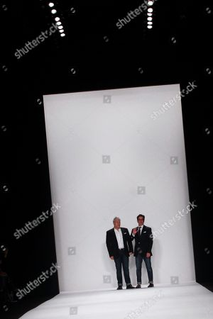 Ken Kaufman and Isaac Franco acknowledge the audience following a showing of their KAUFMANFRANCO Spring 2014 collection during Fashion Week, in New York