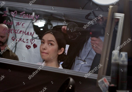 Stock Photo of Feifei Sun, 24, a model from China, gets her hair styled for her appearance in Tommy Hilfiger's Spring 2014 fashion show on in New York