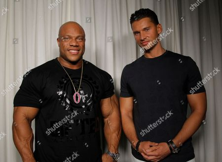 """Stock Photo of Phil Heath Vlad Yudin Director Vlad Yudin, right, and 2012 Mr. Olympia Phil Heath pose for a portrait, in Los Angeles. Heath's quest for the Olympia title is the focal point of Yudin's bodybuilding documentary, """"Generation Iron,"""" which opens in limited release Friday, Sept. 20, 2013"""