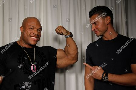 """Phil Heath Vlad Yudin Director Vlad Yudin, right, and 2012 Mr. Olympia Phil Heath pose for a portrait, in Los Angeles. Heath's quest for the Olympia title is the focal point of Yudin's bodybuilding documentary, """"Generation Iron,"""" which opens in limited release Friday, Sept. 20, 2013"""