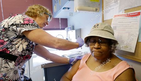 Phyllis Reynolds Phyllis Reynolds, right, gets an annual flu shot from medical assistant Judy Davis at a health clinic, in Seattle