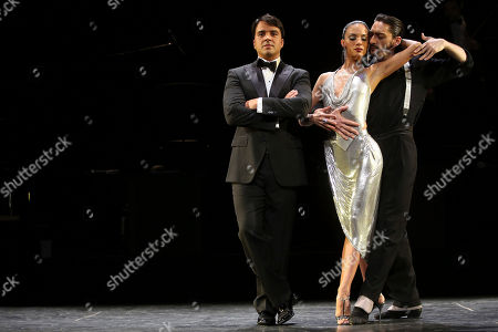 """Luis Fonsi, Victoria Galoto, Juan Paulo Horvath Luis Fonsi, left, poses for photographers with fellow cast members Victoria Galoto, center, and Juan Paulo Horvath during a press preview of """"Forever Tango,"""" at the Walter Kerr theatre in New York"""