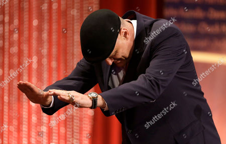 Oscar Schmidt Inductee Oscar Schmidt, of Brazil, bows toward Hall of Famer Larry Bird on stage during the enshrinement ceremony for this year's class of the Basketball Hall of Fame, at Symphony Hall in Springfield, Mass