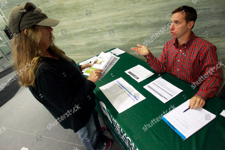 Peter Sterling, right, a navigator for Vermont Health Connect, answers questions for Beverly Beach of Morristown on in Montpelier, Vt. Tuesday is the official startup date for Vermont Health Connect, the state-sponsored health insurance marketplace being set up under the federal Patient Protection and Affordable Care Act. Coverage begins on Jan. 1