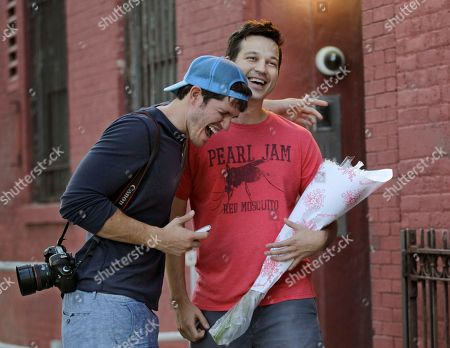"""Brandon Stanton This photo shows photographer Brandon Stanton, creator of the Humans of New York blog, laughing with subject Vic Drabicky, in New York. Stanton's magical blend of portraits and poignant, pithy storytelling has earned HONY more than 2 million followers online. Now he's putting his work in a book, """"Humans of New York,"""" due out Oct. 15 from St. Martin's Press"""