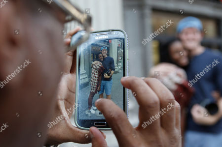 """Stock Image of Brandon Stanton This photo shows Alson Sawdi, left, snapping a photograph of Nina Wentt,18, with street photographer Brandon Stanton, creator of the Humans of New York blog, in New York. Stanton's magical blend of portraits and poignant, pithy storytelling has earned HONY more than 2 million followers online. Stanton's magical blend of portraits and poignant, pithy storytelling has earned HONY more than 2 million followers online. Now he's putting his work in a book, """"Humans of New York,"""" due out Oct. 15 from St. Martin's Press"""