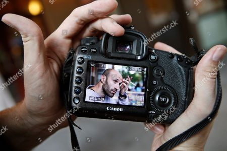 """Brandon Stanton This photo shows a portrait of Rifat Markisic taken by photographer Brandon Stanton, creator of the popular Humans of New York blog in New York. Markisic described himself to Stanton as """"a little bit separate from wife."""" Within hours, the photo was posted on the HONY blog. Stanton's magical blend of portraits and poignant, pithy storytelling has earned the blog more than 2 million followers online. Now Stanton is putting his work in a book, """"Humans of New York,"""" due out Oct. 15 from St. Martin's Press"""