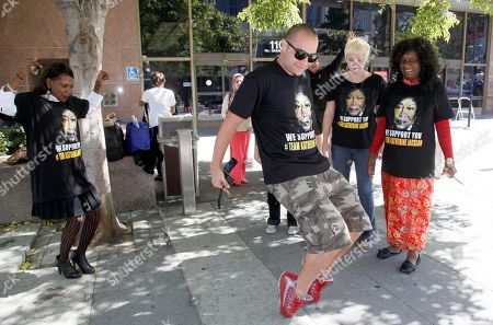 Leo Ryan Leo Ryan dances as other Michael Jackson supporters wait outside court, in Los Angeles. After a bitterly fought five-month trial, a negligence lawsuit by Michael Jackson's mother, Katherine Jackson, against his concert promoter, AEG Live LLC, was placed in the hands of a jury today