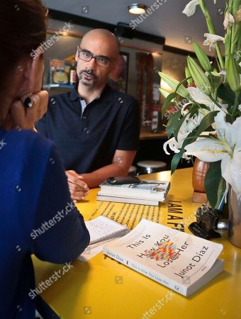 """This photo shows Pulitzer Prize winning author Junot Diaz during an interview in New York. Díaz, who won the 2008 Pulitzer for his book """"The Brief Wondrous Life of Oscar Wao,"""" is a creative writing professor at Massachusetts Institute of Technology. His latest novel,""""This Is How You Lose Her,"""" was released on Sept. 3"""