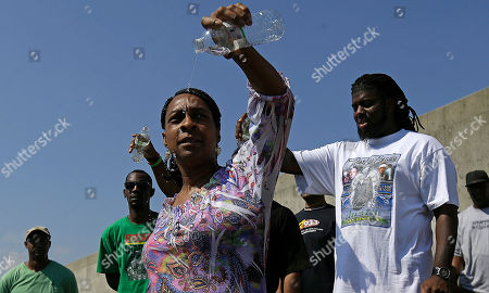 Debra Reed Debra Reed pours water, known as pouring a libation for ancestors, as people call out the names of loved ones who died in Hurricane Katrina, during a ceremony commemorating the eighth anniversary of the storm
