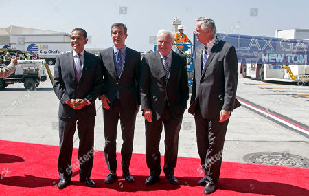Eric Garcetti, Richard Riordan, James Hahn, Antonio Villaraigosa Los Angeles Mayor Eric Garcetti, second from left, poses with former mayors, from left, Antonio Villaraigosa, Richard Riordan, and James Hahn, during the ceremonial grand opening of the Tom Bradley International Terminal at Los Angeles International Airport . The event marks the completion of Phase I of the project, which includes nine new gates that can accommodate the newest generation of large aircraft such as the Airbus 380 and Boeing 747-8, and new dining, shopping and lounge areas. Phase II, set for completion in 2015, will add nine additional big-jet gates and upgraded passenger screening and customs areas