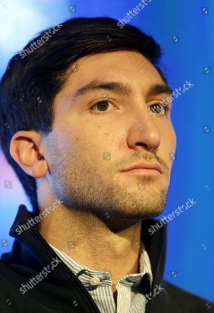 """Evan Lysacek Olympic figure skating champion Evan Lysacek looks on as he speaks to reporters during a press conference during the USOC 2013 team USA media summit, in Park City, in Utah. There were only a handful of fans in the stands, and the lower-level international figure skating competition means little in the grand scheme of this Olympic season. But as Evan Lysacek watched, ice packs on his injured left hip, he felt that familiar rush of adrenaline, tinged with anger that he couldn't compete. Time is running out on the Olympic champion's star-crossed comeback, but one thing is for certain: he's not ready to give up. """"Watching skating competitions still gives me that same fire and desire,"""" Lysacek said"""