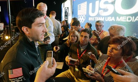 """Evan Lysacek Olympic figure skating champion Evan Lysacek speaks to reporters during a press conference during the USOC 2013 team USA media summit, in Park City, in Utah. There were only a handful of fans in the stands, and the lower-level international figure skating competition means little in the grand scheme of this Olympic season. But as Evan Lysacek watched, ice packs on his injured left hip, he felt that familiar rush of adrenaline, tinged with anger that he couldn't compete. Time is running out on the Olympic champion's star-crossed comeback, but one thing is for certain: he's not ready to give up. """"Watching skating competitions still gives me that same fire and desire,"""" Lysacek said"""