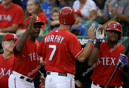 David Murphy, Jackie Moore, Ron Washington, Adrian Beltre Texas Rangers bench coach Jackie Moore, from left, Ron Washington and Adrian Beltre, right, congratulate David Murphy (7) at the dugout entrance after Murphy scored on an Elvis Andrus single in the second inning of a baseball game, in Arlington, Texas