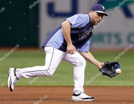 Luke Scott Tampa Bay Rays' Luke Scott fields a ground ball at third base before a baseball game against the Seattle Mariners, in St. Petersburg, Fla