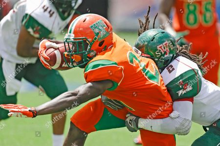 James Owens, Kevin Eugene Florida A&M running back James Owens, left, is tackled by Mississippi Valley State defensive back Kevin Eugene (2) during the first half of an NCAA college football game in Orlando, Fla