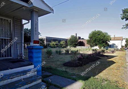 A flower garden marks the site of the former home of Ariel Castro on Seymour Avenue in Cleveland, on . Castro, 53, serving a life sentence for the kidnapping and rape of three women, was found hanging in his cell Tuesday night, Sept. 3, 2013, at the Correctional Reception Center in Orient, Ohio