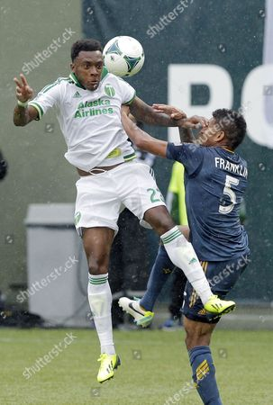 Rodney Wallace, Sean Franklin Portland Timbers forward Rodney Wallace, left, competes for the ball with Los Angeles Galaxy defender Sean Franklin during the second half of an MLS soccer game in Portland, Ore., . The Timbers won 1-0