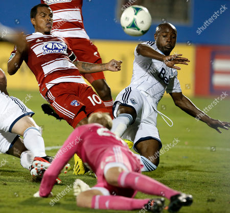David Ferreira, David Ousted, Joe Cannon FC Dallas midfielder David Ferreira attempts a shot as Vancouver Whitecaps' Nigel Reo-Coker, top right, and goalkeeper David Ousted, bottom, combine to deflect the shot in the first half of an MLS soccer game, in Frisco, Texas
