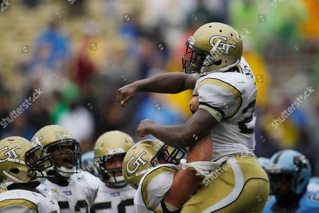 Georgia Tech running back David Sims (20) reacts to his touchdown with team mates during the second half of an NCAA football game against the North Carolina, in Atlanta