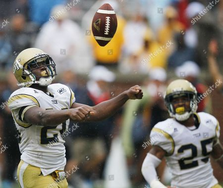 Georgia Tech running back David Sims (20) tosses the ball away after scoring a touchdown against the North Carolina during the second half of an NCAA football game, in Atlanta. Georgia Tech won 28-20