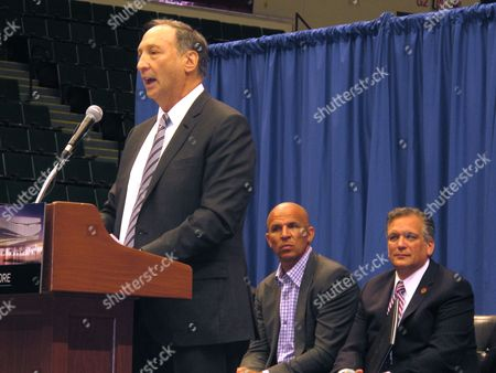 Developer Bruce Ratner speaks at a press conference, at the Nassau Veterans Memorial Coliseum in Uniondale, N.Y. Nassau County officials have announced that a group headed by Ratner will head a $229 million renovation of the coliseum. Behind Ratner are Brooklyn Nets coach Jason Kidd, center, and Nassau County Executive Edward Mangano, right
