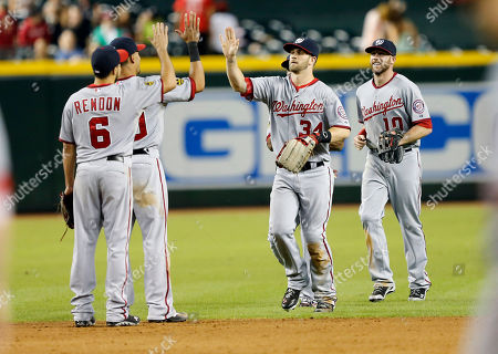Anthony Rendon, Ian Desmond, Bryce Harper, Corey Brown From left; Washington Nationals' Anthony Rendon (6) Ian Desmond, Bryce Harper and Corey Brown celebrate their win after a baseball game against the Arizona Diamondbacks, in Phoenix. The Nationals won 8-4