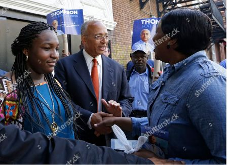 Bill Thompson New York City Democratic Mayoral hopeful Bill Thompson, center, greets members of the West African community while campaigning in Harlem, in New York