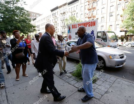 Bill Thompson New York City Democratic Mayoral hopeful Bill Thompson, center, in suit, greets a well-wisher on the street as he campaigns with members of the West African community on a small business tour in Harlem, in New York