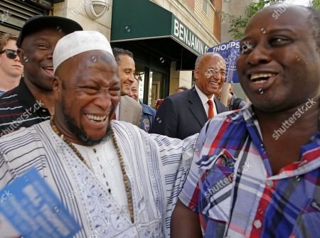 Imam Souleiman Konate, Bill Thompson Malian Imam Souleimane Konate, second from left, shares a laugh with New York City Democratic Mayoral hopeful Bill Thompson, rear, second from right, during a tour of West-African-owned business in Harlem, in New York