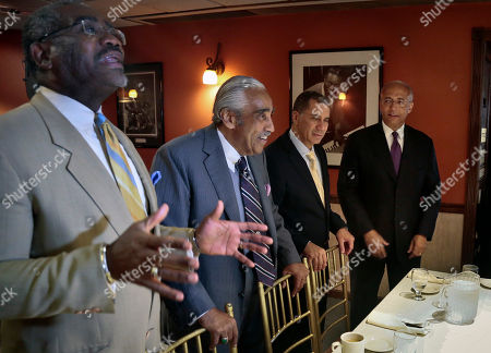 Rep. Gregory Meeks, D-N.Y., left, is joined by Rep. Charlie Rangel, D-N.Y., second from left, and former New York Gov. David Patterson, second from right, as he welcomes New York City mayoral candidate Bill Thompson, far right, to a breakfast meeting of African American political and civic leadership supporting his candidacy, on in the Harlem neighborhood of New York's Manhattan borough