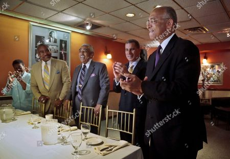 Assemblywoman Annette Robinson, far left, Rep. Gregory Meeks, D-N.Y., second from left, Rep. Charlie Rangel, D-N.Y, center, and former New York Gov. David Patterson, second from right, react after the introduction of New York mayoral candidate Bill Thompson, far right, during a breakfast meeting of African American political and civic leadership supporting his candidacy, in the Harlem neighborhood of New York's Manhattan borough