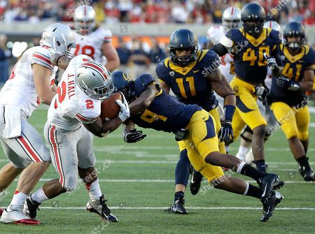 Jason Gibson, Jordan Hall Ohio State's Jordan Hall (2) breaks the tackle of California's Jason Gibson (9) for a touchdown during the second half of an NCAA college football game, in Berkeley, Calif