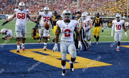 Jordan Hall Ohio State's Jordan Hall (2) celebrates after scoring a touchdown against California during an NCAA college football game in Berkeley, Calif. Carlos Hyde was the unbeaten Buckeyes' leading scorer and second-leading rusher a year ago. Now he'll be battling Hall and others for carries as head coach Urban Meyer tries to sort out an abundance of riches