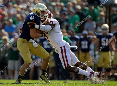 Stock Picture of Andrew Hendrix, Corey Nelson Notre Dame's Andrew Hendrix, left, is tackled by Oklahoma's Corey Nelson (7) during the first half of an NCAA college football game, in South Bend, Ind