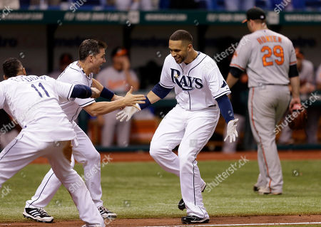 Yunel Escobar, Luke Scott, James Loney, Tommy Hunter Tampa Bay Rays' James Loney, second from right, greets teammates Yunel Escobar, left, and Luke Scott, second from left, after hitting a ninth-inning, game-winning home run off Baltimore Orioles relief pitcher Tommy Hunter, right rear, during a baseball game in St. Petersburg, Fla. The Rays won 5-4. Hunter knows there will come a time this season when he blows a ninth-inning lead to turn a potential victory into a frustrating defeat. The manner in which the right-hander reacts to that disappointment could go a long way toward determining his success as the Baltimore Orioles' new closer