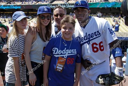 Yasiel Puig, Andy Garcia, Daniella Garcia, Dominik Garcia, Andres Garcia Dodger outfielder Yasiel Puig, right, and actor Andy Garcia, center rear, both born in Cuba, are joined by Garcia's children, from left, Daniella, Dominik and Andres, before a baseball game between the San Diego Padres and the Los Angeles Dodgers in Los Angeles