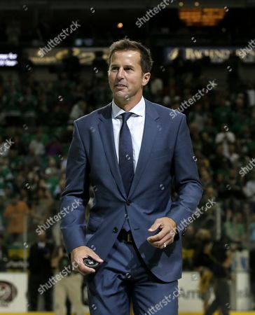 Mike Modano Former Dallas Stars player Mike Modano walks off the ice after participating in the ceremonial puck drop before an NHL hockey game between the Stars and the Florida Panthers, in Dallas