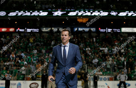Mike Modano Former Dallas Stars player Mike Modano walks off the ice after dropping the ceremonial puck before an NHL hockey game between the Stars and the Florida Panthers, in Dallas