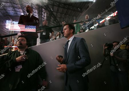 Mike Modano Former Dallas Stars player Mike Modano, center, tosses a puck up and down in his hand as awaits his introduction onto the ice for the ceremonial puck drop before the Stars season opener against the Florida Panthers in an NHL hockey game, in Dallas. The Panthers won 4-2