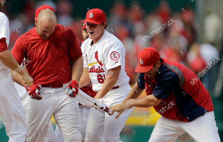 Matt Holliday, Shelby Miller, David Freese St. Louis Cardinals' Matt Holliday, left, has his jersey ripped off by teammates Shelby Miller and David Freese, right, after hitting a walk-off single to defeat the Pittsburgh Pirates in a baseball game, in St. Louis. The Cardinals won 6-5