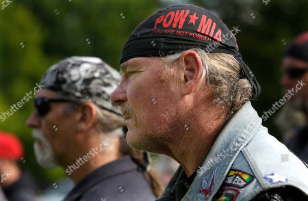 Stock Picture of Robby Robertson Robby Robertson, right, a motorcycle-riding member of Rolling Thunder, a POW/MIA remembrance organization, listens to a speaker during a ceremony, in Olympia, Wash., that was part of National POW/MIA Recognition Day. Robertson served in the Army during the Vietnam War